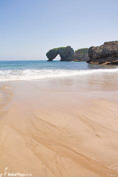 La Huelga beach in Llanes, Asturias. The peculiar rock is called Castro de las Gaviotas (the rock of the Seagulls)