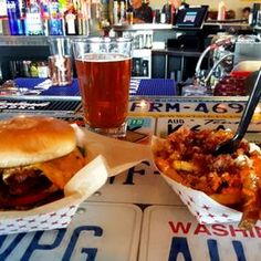 Photo of Smitty's Garage Burgers and Beer - Omaha, NE, United States. The Egg-a-nator (Egg, Bacon, American Cheese, Tomato) Thunder Fries, and a Deschutes Freshly Squeezed.