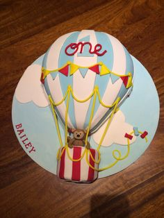Hot air balloon cake for boys first birthday party.