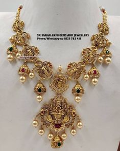 Nakshi work necklaces all.new designs. Stunning gold necklace in nakshi work. Necklace with south sea pearl hangings. Visit for full variety. Contact no 8125 782 22 November 2019 Gold Jewelry Simple, Golden Jewelry, Ruby Jewelry, Bridal Jewelry, Diamond Jewelry, Fine Jewelry, Gold Temple Jewellery, Gold Jewellery Design, Designer Jewellery
