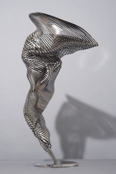 "Motion. By Andrew Rogers. Motion 2014 Stainless Steel 100 H x 41 W x 56 D cm (39""x16""x 22"")"