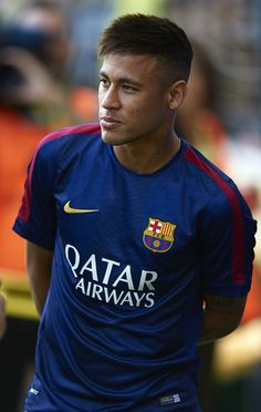 Neymar JR Photos - Neymar JR of Barcelona looks on prior the La Liga match between Villarreal CF and FC Barcelona at El Madrigal stadium on August 2014 in Villarreal, Spain. - Villarreal CF v FC Barcelona - La Liga