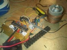 How to make a simple induction heater. This project is really simple, and surprisingly effective at heating metals using high frequency magnetic fields. Induction Forge, Induction Heating, Simple Diy, Easy Diy, Nimh Battery Charger, Metal Working, Chopper, Welding, Projects