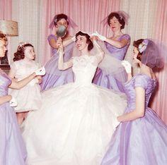 Midcentury bride with lavender bridesmaids