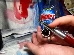 Aibrushing:  Mixing Acrylic Paint with Windex. This video shows my method for thinning Vallejo acrylic paint with Windex for use in an Airbrush.
