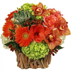 Great centerpiece for Thanksgiving. Love the twig base and the floral textures