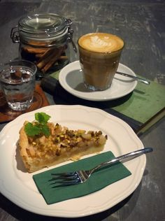 Our amazing gluten free Pear pie with pistachios - a perfect combination with our Flat White! #labohemecafe #design #interior #flatwhite #coffee #coffeelovers #cake #prague #laboheme