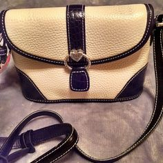 Beautiful and authentic Brighton purse Beautiful authentic Brighton purse in white and black. 4th picture shows minor discoloration that may come off with a wet cloth. This is just from its own leather strap. Purse never used.  Brighton Bags