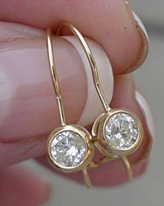 Yellow Gold Bezel Diamond Earrings - Dangle Solitaire Brilliant Round Half Carat 0.50 carat by LuxinelleJewelry on Etsy https://www.etsy.com/listing/259737496/yellow-gold-bezel-diamond-earrings