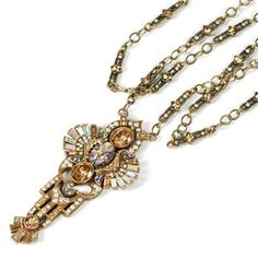 Art Deco Necklace Sublime pattern in crystals, colors historically correct. Touch up lipstick with mirror on the back of pendant. Signed and Copyrighted Sweet Romance USA