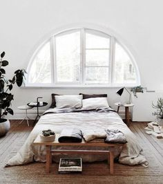 Cosy and white bedroom: arch window and little tables for odds. #painters #decorators #builders #tilers #London #bedroom #arch