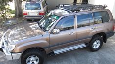 Toyota LandCruiser 100 Series with short, open ended Oval Alloy roof rack to fit sunroof