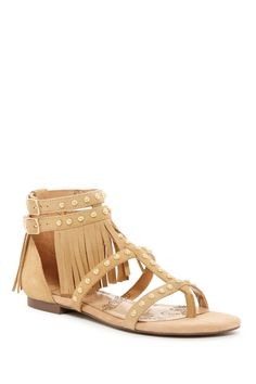 b0861996ac7 Add a little boho to your look with these comfy yet stylish fringe studded  sandals.