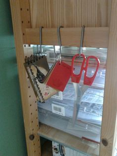 handy tip I discovered by luck. Ikea Ivar shelving system end panels (the cross brace wood piece) and Ikea Bygel rail system hooks are compatible - making handy little storage hooks for wherever you use your Ivar (mines in my craft room)