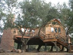 this 1000 square foot treehouse features a full bath, kitchen, running water and washer/dryer.