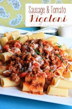 Sausage & Tomato Rigatoni - A simple weeknight dinner of italian sausage in a garlic basil tomato sauce and served over rigatoni. 20 minutes from stove to table!