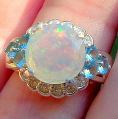 Opal Ring, Sterling Silver Ring, Welo Opal Ring, Peach Green Fire, Ethiopian Opal Ring, Natural Stone, Mined in Ethiopia by JanesGemCreations on Etsy https://www.etsy.com/listing/187618017/opal-ring-sterling-silver-ring-welo-opal