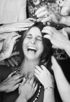 """A woman laughs uproariously as she undergoes a """"head-tapping session,"""" part of a sensory awareness class in an encounter group at the Esalen Institute in 1970."""