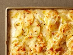 Four-Cheese Scalloped Potatoes : To make this decadent side dish, layer thinly sliced potatoes with heavy cream and mozzarella, asiago and raclette cheeses. Top with Parmesan cheese and bake until bubbly.