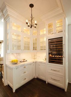 Butler pantries are no longer an afterthought. Add lights inside glass cabinets to enhance the elegance of the space.