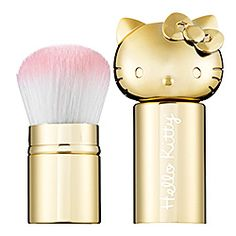 What it is:A delightful kabuki brush with a metallic gold finish.What it does:This versatile brush is great for the girl on the go who likes to keep a little Hello Kitty with her at all times. Use it to effortlessly apply loose powder, pressed pow