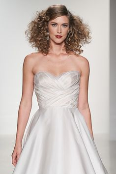 Lavish sequin lining glistens through this all over rosette lace gown. This modified trumpet dress sparkles from the scalloped sweetheart neckline to the scalloped laced trimmed hem. One added thin middle layer of tulle dampens the sequin fabrication to create the perfect balance of sophistication and shimmer. Covered buttons extend to the end of the chapel length train.<br ></a>Lining: Champagne, Off White, Deep Ivory, Mocha<br />Sequin Fabric, Tulle, Lace: Off White