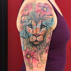 Sketchy watercolor style lion on the upper arm/shoulder. Tattoo Artist: Dino Nemec