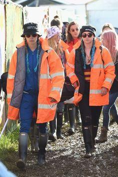 e48afc5f2ad Cara Delevingne models her high vis jacket at Glastonbury 2016 Image credit  - www.vogue