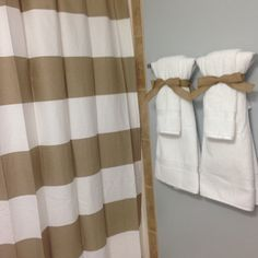 Bathroom staging to sell your home. Neutral colors, crisp white towels, tied up with burlap bow (also helps so your family won't use your display towels)