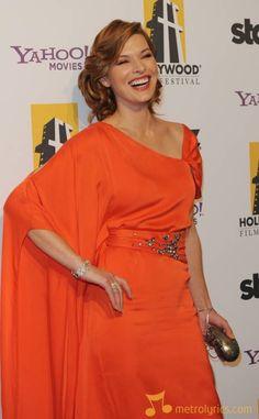 milla jovovich orange dress