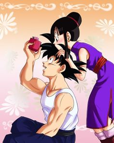 "*chuckles softly* ""Oh yeah, that's right..."" *fishes box clumsily from pocket* ""here, I brought you back something, ChiChi!"" *....>x<...!! So cute!*  --ChiChi+Goku -DBZ"