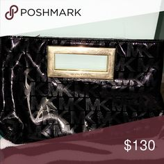 Handbag MK this is a great Clutch Handbag . you could use this as a makeup bag or just a small purse. Michael Kors Bags Clutches & Wristlets