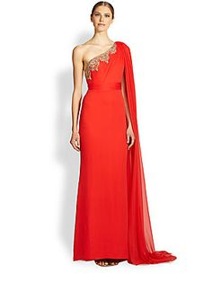 Notte by Marchesa Draped One-Shoulder Silk Gown 1095.00...A statuesque silk gown inspired by the glamorous lehenga saree, draped at one shoulder with a panel of semi-sheer chiffon that grazes the floor to trail alongside a striking full train.