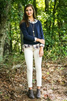 ecru skinny jeans + plaid button up + navy sweater