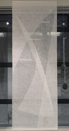 Hand woven transparent weave of linen by Helena Vento.