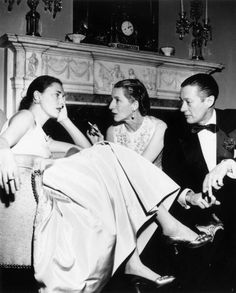 'Park Avenue' Diana Vreeland with her husband Reed chatting to slim Hawks at a New Years Eve party, 1952