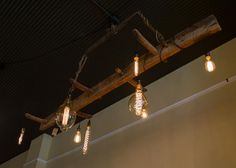 Antique Industrial Horse-Drawn Chandelier with Edison bulbs. - Chestnut Studios, Lindsborg, KS