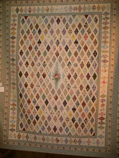 Four of Diamonds    By Anne Page.  When Anne's dear friend Thelma died, her husband gave her the piece of fabric that Anne has used as the centre piece. It is a copy of Jane Austen's quilt.  Winner of Members' choice and Viewers' choice.