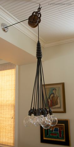 Antique-Pulley-adds-interest-to-Dining-Room-Fixture-CynthiaWeber.com_.png 600×1,193 pixels