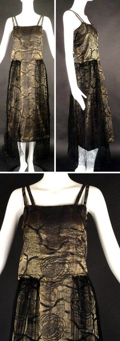 Evening dress, J.W. Robinson Co., Los Angeles, ca. 1918. Gold bullion with Art Nouveau floral design. Pleated fly-front bodice with double straps wraps at back. Gored skirt falls from slightly dropped waistline. Overskirt in black Chantilly lace falls in gathers lower than skirt's hemline from edge of bodice. Snap & hook closures at back waistline. Vintage Martini