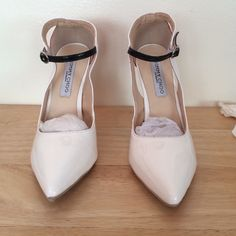 BRAND NEW JIMMY CHOO SHOES Brand new Jimmy CHOO shoes never worn with black heel and strap accented with red backing Jimmy Choo Shoes Heels
