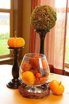 mini pumpkins on candlesticks - neat idea