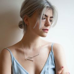 Stave  £130.00  The simplicity of the design makes the Stave necklace an easy to wear, go to piece. Its brushed finish gives the silver a warmth, a signature of the collection. The Stave necklace stands out beautifully on a darker outfit, however can just as easily be worn with anything.