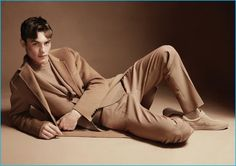 Dressed in camel wool fashions, Kit Butler dons a Joseph sweater, suit and coat with Fred Perry sneakers.