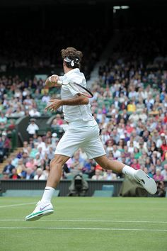Roger Federer hits a forehand to Xavier Malisse. - Matthias Hangst/AELTC