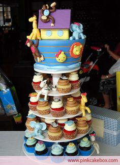 Cake idea! I like the Noah's ark cake as a centerpiece and the tiered cupcake look!