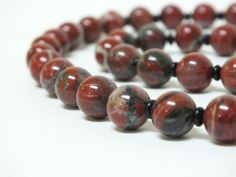 Beautiful rich red jasper with streaks of white and gray and tiny black spacers
