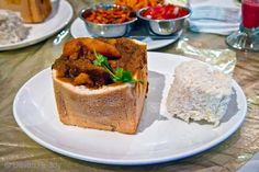 Bunny Chow has become one of Durban's most famous exports! It's usually called a 'bunny' and brings back youthful memories for many Durbanites who used to stop for a bunny chow on their way home from late night clubbing. A bunny is basically made from hal South African Dishes, South African Recipes, Indian Food Recipes, Beef Curry, Lamb Curry, Tasty, Yummy Food, Chow Chow, Curry Recipes