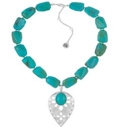 Colored turquoise beads sit on the collarbone for a bright, statement-making accent in the Silverlake Beaded Pendant Necklace in Turquoise and Silver. An etched silver pendant hangs at the end of this extendable necklace, making a fun conversation piece.