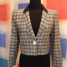 "VALENTINO Short Blazer Vintage. Authentic Valentino tweed blazer, black & ivory plaid, with all black collar. Structured cut with a single button closure. Padded shoulders. Wool 75% & silk 25%. Fully lined. Measures 18"" in length from shoulder seams. Made in Italy. Marked size 38. Valentino Jackets & Coats Blazers"